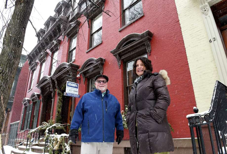 Real estate agent Daniel McCarthy, left, stands with homeowner, Kathe Kennedy, right, outside her Second Street historic property, which is for sale on Monday, Feb. 18, 2019, in Troy, N.Y.  (Will Waldron/Times Union) Photo: Will Waldron / 40046216A