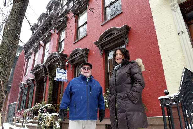 Real estate agent Daniel McCarthy, left, stands with homeowner, Kathe Kennedy, right, outside her Second Street historic property, which is for sale on Monday, Feb. 18, 2019, in Troy, N.Y. (Will Waldron/Times Union)