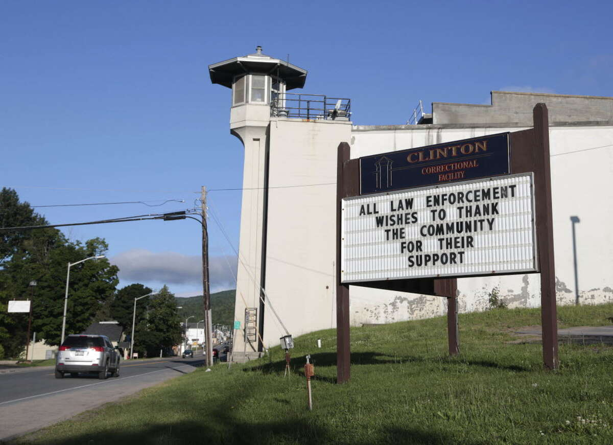 A sign at Clinton Correctional Facility thanks the community as the search for two escaped prisoners from the facility continues, on Wednesday, June 24, 2015, in Dannemora, N.Y. Hundreds of searchers checked ATV trails and logging roads and went door-to-door in far northern New York trying to close in on David Sweat and Richard Matt, who escaped from the maximum-security prison more than two weeks ago. (AP Photo/Mike Groll)