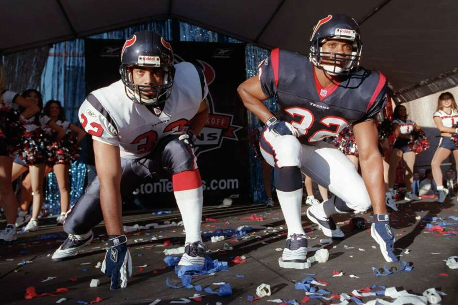 Models get down and show the Texans' new uniforms Tuesday, September 25, 2001, at the Wortham Center in Houston. Celebrities, former players, cheerleaders and fans packed the area to get a look at the new uniforms. CHRISTOBAL PEREZ/HOUSTON CHRONICLE. HOUCHRON CAPTION (09/26/2001): The Texans put their best foot forward with Tuesday's uniform unveiling.