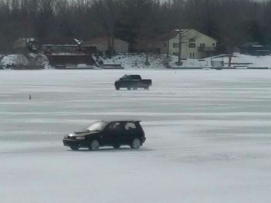 Vehiclestake to ice-covered Ross Lake in Beaverton during a previous winter race. (Courtesy photo)