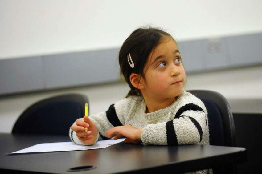 >>Click through to see how southern Connecticut's schools ranked on The state's Next Generation Accountability indexes Pictured: Caitlyn Sherman, 6, looks to instructor Nancy Miller after she considers the answer to a math problem during the Greenwich-Stamford math circle inside UConn Stamford in downtown Stamford, Conn. on Sunday, Jan. 7, 2018. The math circle, which is run by the Chinese Language School of Connecticut, provides a stimulating environment for ambitious students who wish to gain a deeper understanding of mathematics.