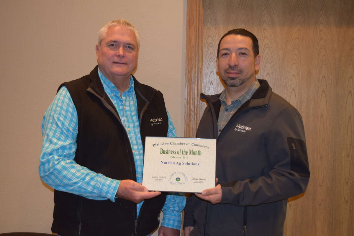Gary Koelder and Leo Molina accepted the Business of the Month award for Nutrien Ag Solutions during a morning Chamber of Commerce meeting on Tuesday.