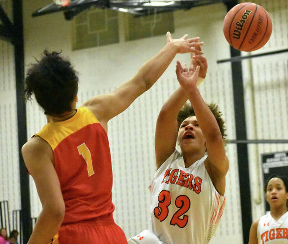 Edwardsville's Maria Smith (right) has her shot blocked by Rock Island's Brea Beal in the first quarter Thursday night at the Normal West Class 4A Sectional. Photo: Matt Kamp / Hearst Illinois