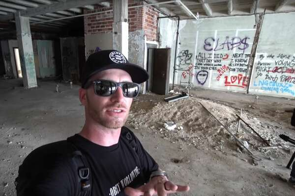 New York-based Youtuber Robb Atch (pictured here) has made the trek to the Bayou City to go exploring with Soto several times. Here the two are seen exploring a skyscraper trap house in Houston. Photo by: Robb Atch/rnk.all.day