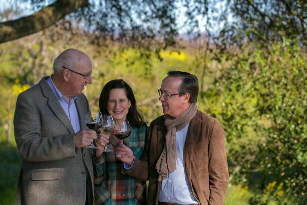 Ken Coopersmith, left toasts wife Merry Edwards and French Champagne company Louis Roederer's President, Frederic Rouzaud after purchasing the iconic Sonoma County winery, Merry Edwards Winery, Thursday February 21, 2019, in Sebastopol, Calif.