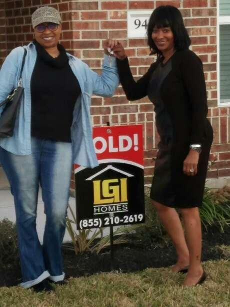"""Real estate agent Vernice Ross hand Neveda Bryant the keys to her new home in March of 2017. Both Ross and Bryant are California transplants living in the Houston area, two of the over 63,000 Californians who move to Texas a year.""""Affordability, affordability, affordability — that's the main reason people are leaving California and moving to Texas,"""" Ross said."""
