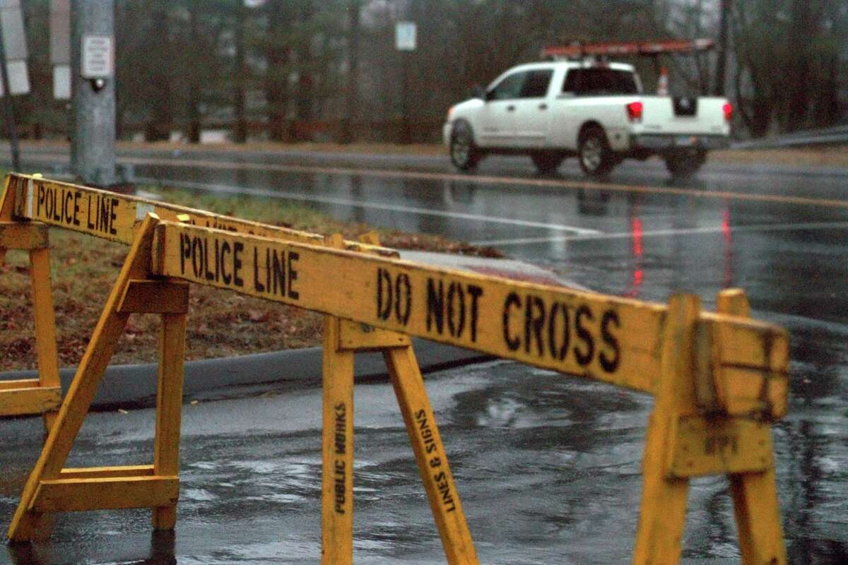 FILE PHOTO: A police barricade warns motorists to a flooded Broadbridge Road in Bridgeport, Conn., on Friday, Dec. 28, 2018. Many vehicles went through the flooded intersection anyway.