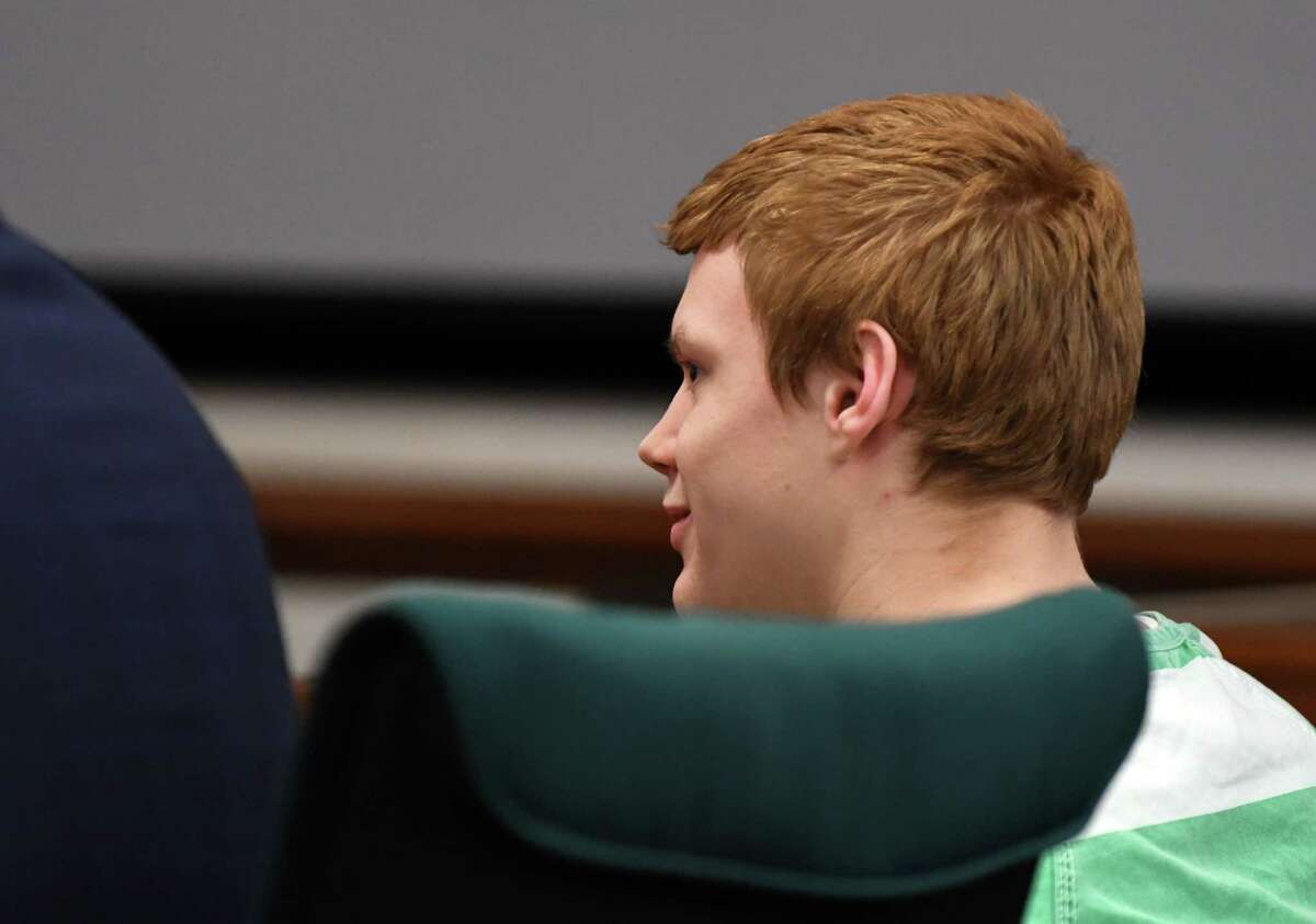 """Adrian Sawyer, 16, smirks as he tells Judge Kelly McKeighan """"I'm alright,"""" when asked if he would like to make statement during his sentencing for the murder of Maverick Bowman, 15, on Friday, Feb. 22, 2019, at the Washington County Courthouse in Fort Edward, N.Y. Sawyer was sentenced to 20 years to life for the second-degree murder charge. (Will Waldron/Times Union)"""