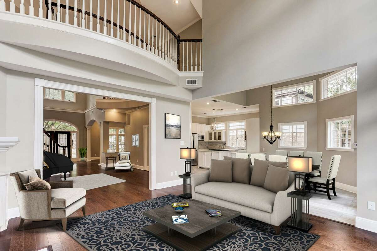Virtual staging is the practice of populating photographs of real rooms with digital furniture so that potential buyers and envision ways to use the space. Here, a living room has been virtually staged.