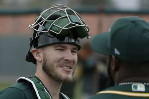 Oakland Athletics' Chris Herrmann at their spring baseball training facility in Mesa, Ariz., Thursday, Feb. 14, 2019. (AP Photo/Chris Carlson)