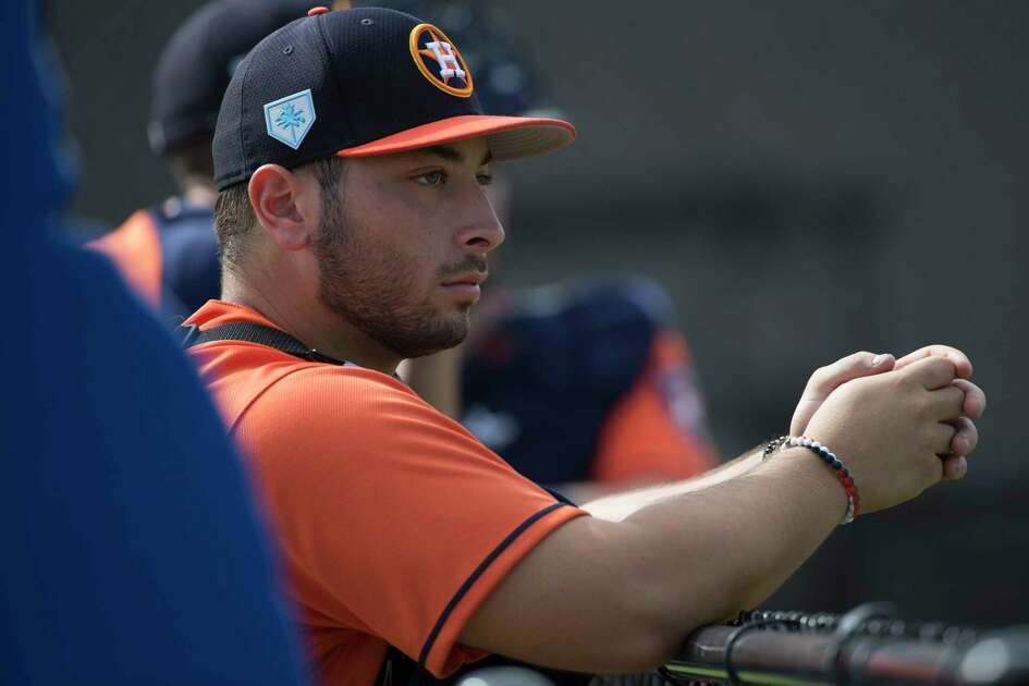 Houston Astros minor league catcher Scott Manea rests after working in the bullpen at Fitteam Ballpark of The Palm Beaches on Day 9 of spring training on Friday, Feb. 22, 2019, in West Palm Beach.