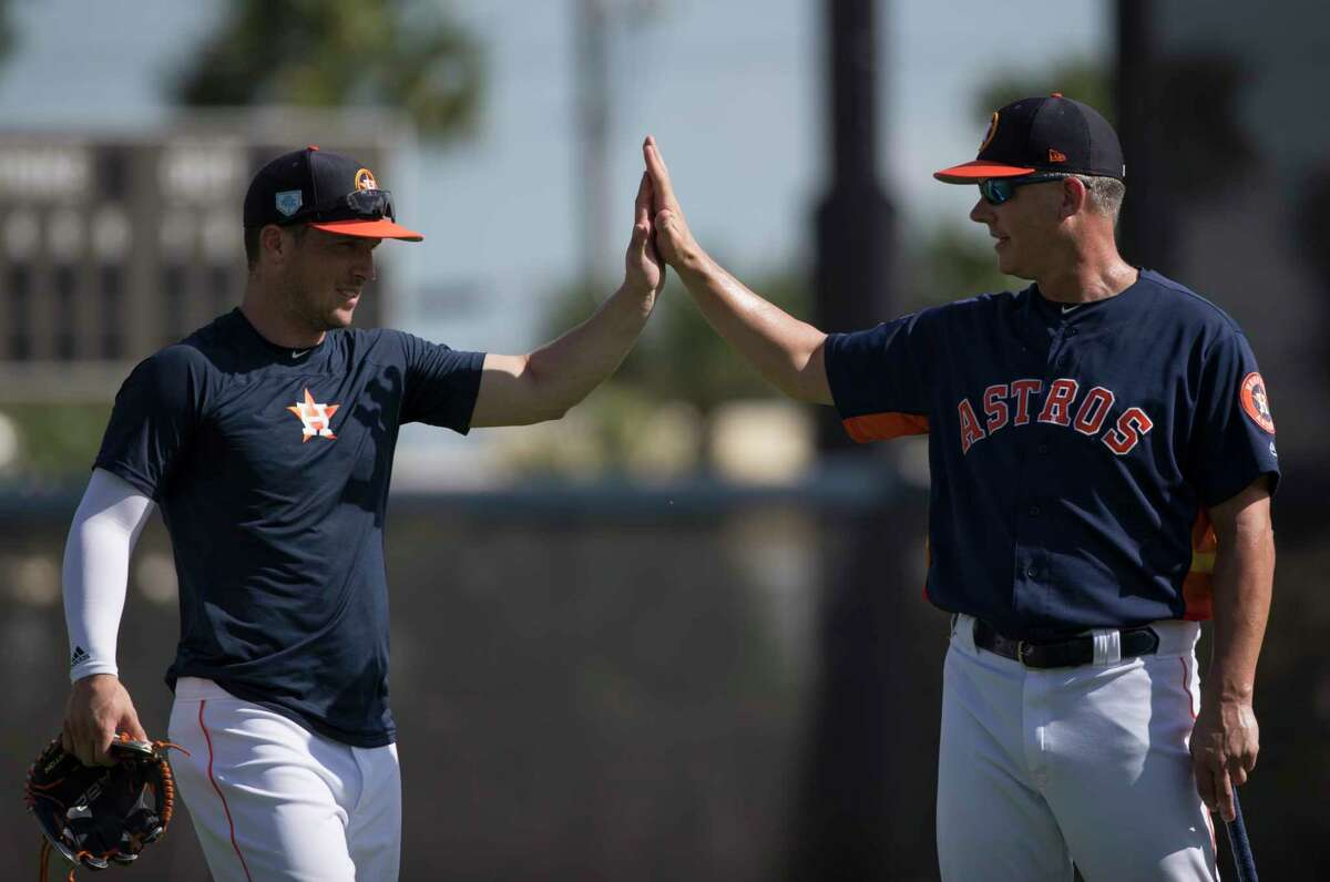 Alex Bregman, left, is among the many stars under the command of manager A.J. Hinch, who's set a high bar for success during his first four seasons with the Astros.