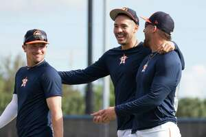 Houston Astros third baseman Alex Bregman, from left, shortstop Carlos Correa and outfielder George Springer between practices at Fitteam Ballpark of The Palm Beaches on Day 9 of spring training on Friday, Feb. 22, 2019, in West Palm Beach.