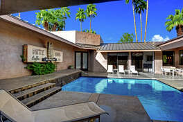 Hollywood set decorator Jay Hart has listed his Palm Springs, Calif., home, which he reimagined, for sale at $2.195 million. The updated contemporary features an entry courtyard with a swimming pool, high-ceiling common areas and an office. (TTK Represents/TNS)