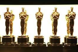 FILE - In this Feb. 26, 2017 file photo, Oscar statuettes appear backstage at the Oscars in Los Angeles. Responding to widespread backlash to the fact that four Oscars will be presented during commercial breaks at the 91st Academy Awards, the film academy has issued a statement reiterating that all Academy Award winners will still be included in the broadcast on Feb. 24, just not all live. (Photo by Matt Sayles/Invision/AP, File)