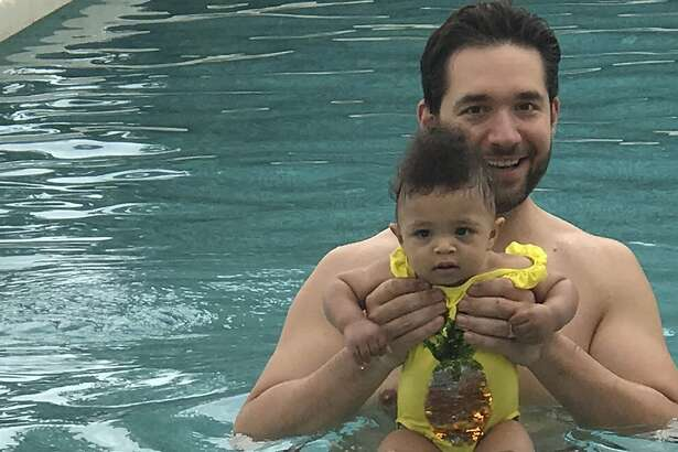 In this undated photo provided by Edelman communications marketing firm, Alexis Ohanian, founder of the social media company Reddit, poses for a photo with his daughter Olympia. Ohanian wants other guys to be jealous of him. Not because he's a multimillionaire venture capitalist. Or because he's married to tennis pro Serena Williams. The Reddit co-founder wants men to covet the time he gets to spend with his 1-year-old daughter, Olympia. (Edelman via AP)