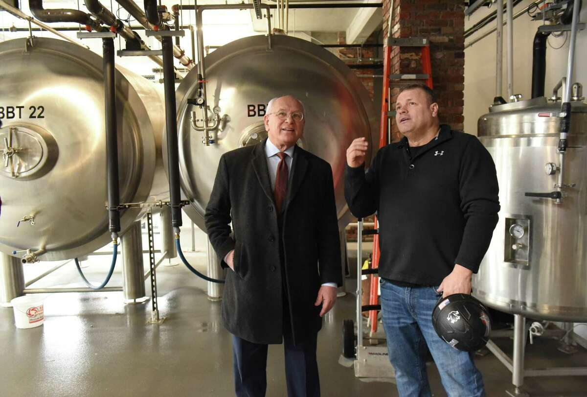 Developer JT Pollard, right, takes Congressman Paul Tonko on a tour of the Frog Alley Brewing in the Mill Artisan District construction project on Friday, Feb. 22, 2019 in Schenectady, N.Y. (Lori Van Buren/Times Union)