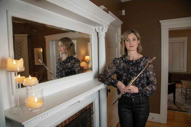 Elizabeth Rowe, principal flute player of the Boston Symphony Orchestra at her home in Boston, Massachusetts.