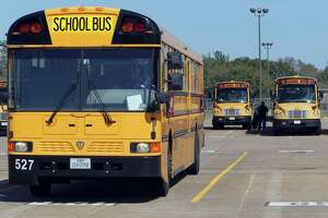 A school bus drivers parks a bus at the end of the day at one of Katy Independent School District bus barns Tuesday, March 18, 2014, in Houston. ( James Nielsen / Houston Chronicle )