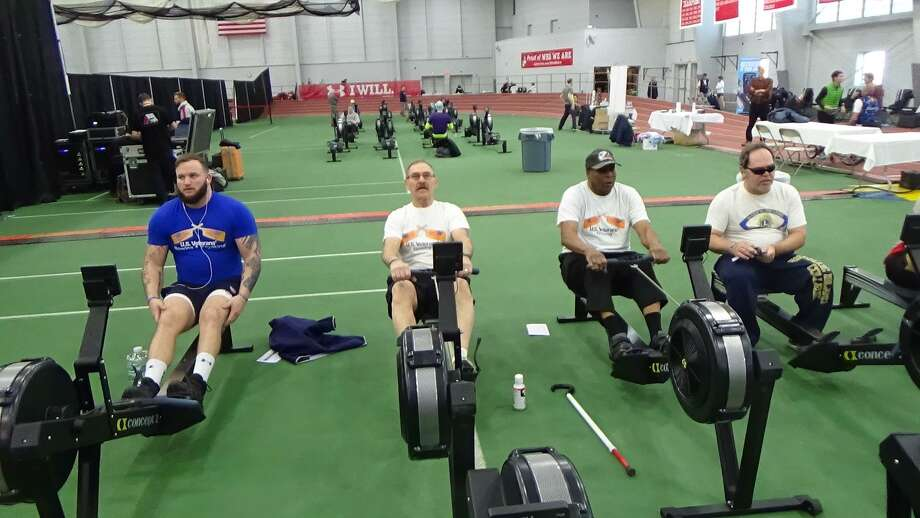 Representing Connecticut, Jerry Augustine of Middletown (second from left) took part in the annual World Indoor Rowing Championships, CRASH B Sprints in Boston, recently. He took home a bronze medal in his class for the 2,000-meter adaptive race. Photo: Contributed Photos