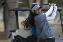 Midland High's Anaya Perales follows her tee shot 02/22/2019 in the Tall City Girls Golf Invitational at Ranchland Hill Golf Club. Tim Fischer/Reporter-Telegram