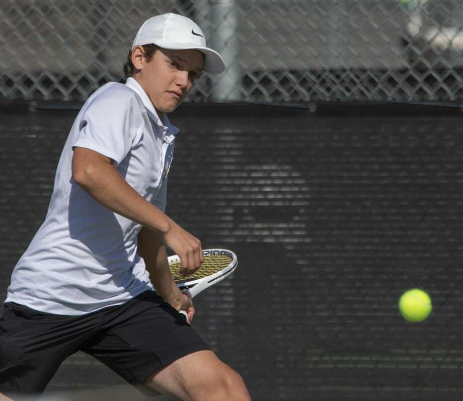 Midland High's Tyler Stewart returns a shot 02/22/2019 in the Tall City Tennis Invitational at Bush Tennis Center. Tim Fischer/Reporter-Telegram Photo: Tim Fischer