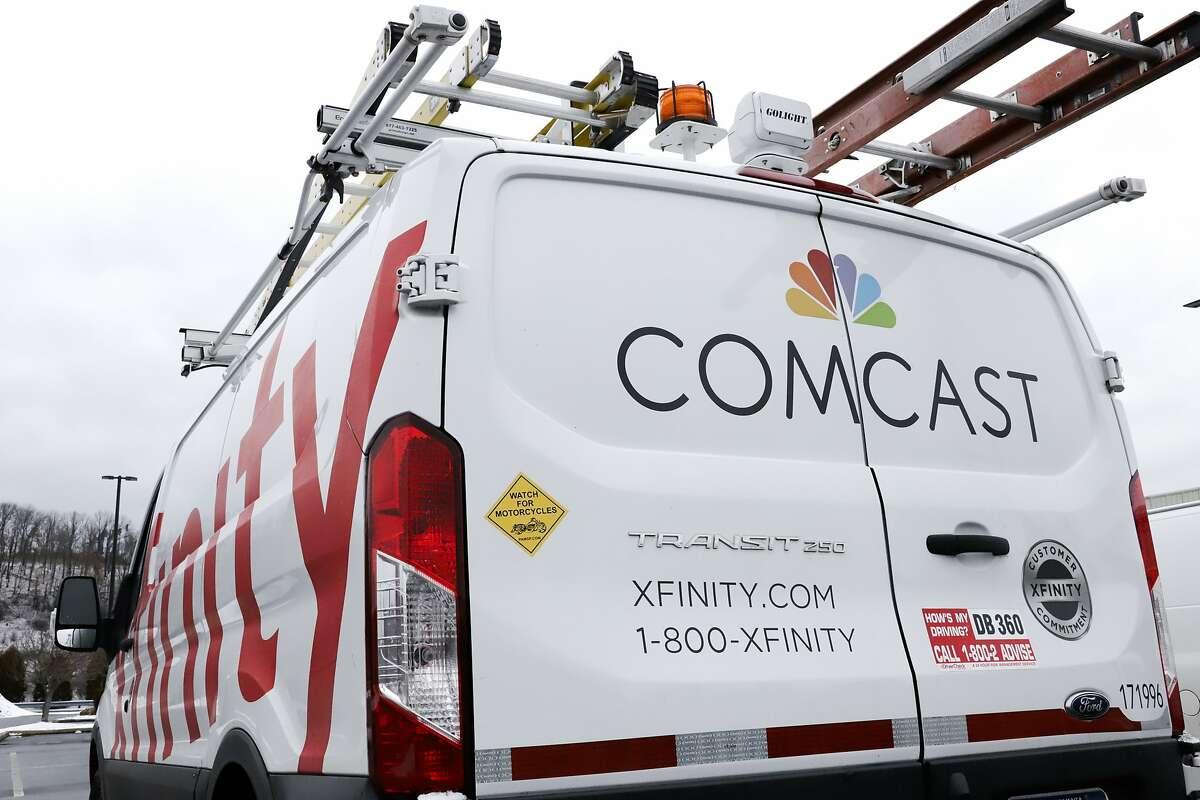 This is a Comcast truck in Pittsburgh Thursday, Jan. 24, 2019. (AP Photo/Gene J. Puskar)