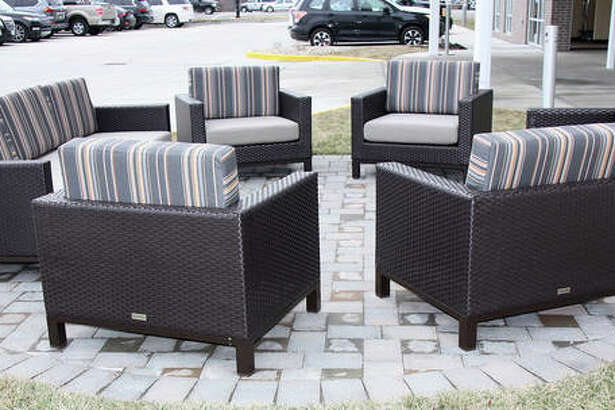 Patio furniture greeted visitors and guests at the grand opening of the Marriott TownePlace Suites on Center Grove Road Thursday. The 91-suite hotel has five floors.