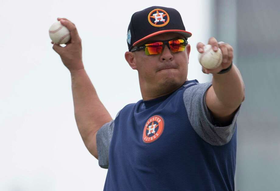New first base coach Omar Lopez, seen here throwing batting practice during 2019 spring training, is entering his 22nd season with the Astros organization. Photo: Yi-Chin Lee, Staff Photographer / © 2019 Houston Chronicle