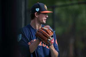 Houston Astros right handed pitcher Forrest Whitley (68) throws exercise balls before throwing program at Fitteam Ballpark of The Palm Beaches on Day 9 of spring training on Friday, Feb. 22, 2019, in West Palm Beach.