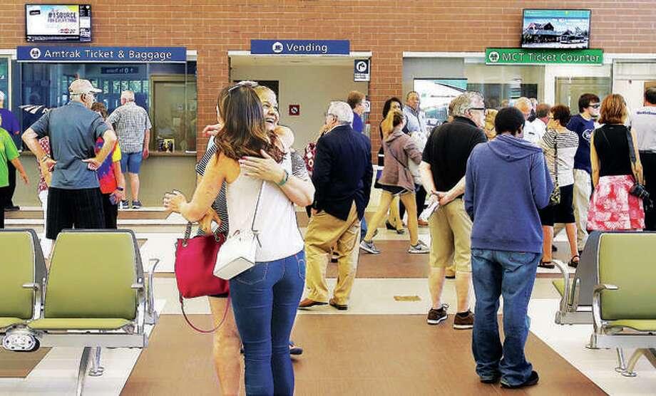 Friends embrace inside the Alton Regional Multimodal Transportation Center. Photo: John Badman | The Telegraph