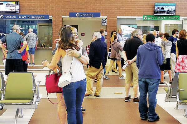 Friends embrace inside the Alton Regional Multimodal Transportation Center.