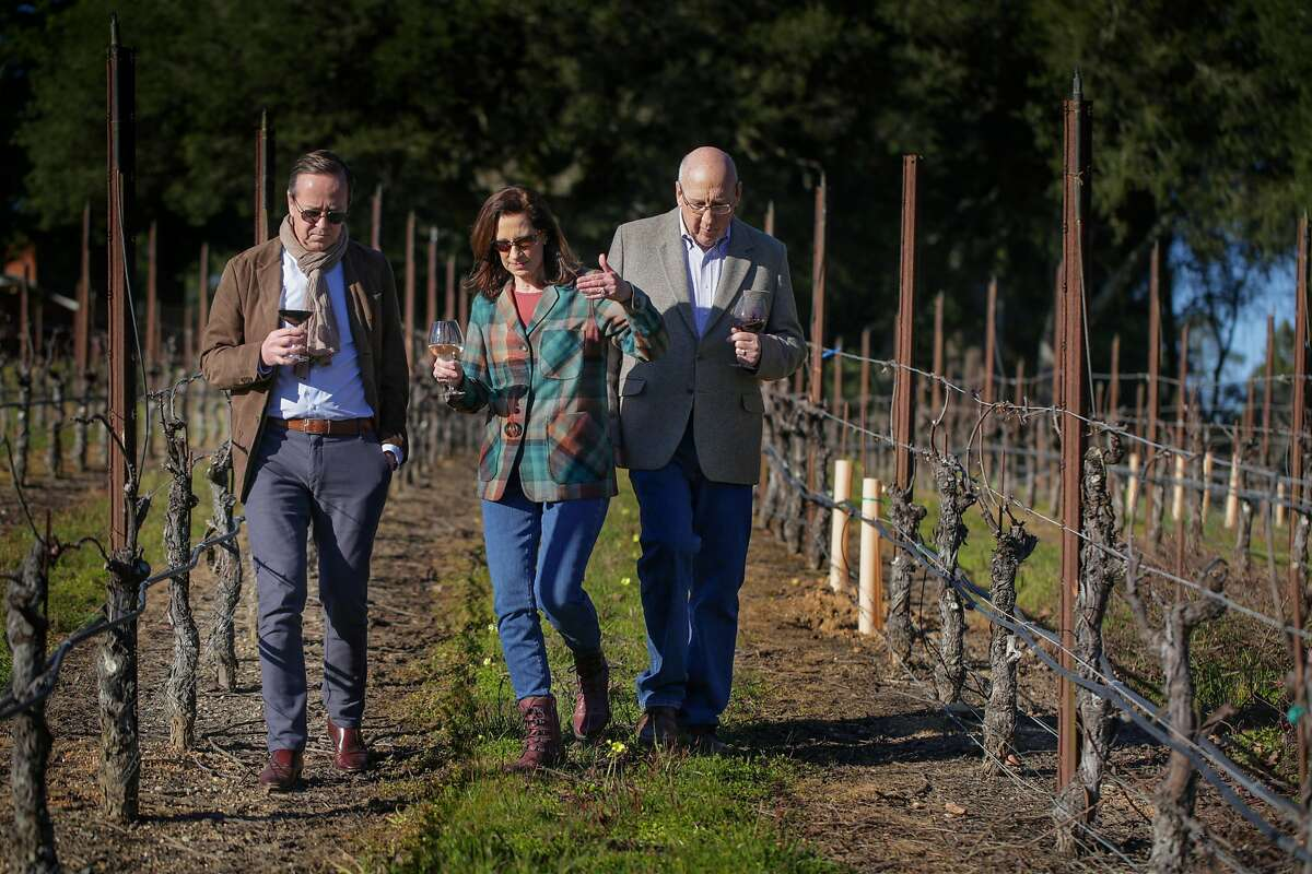 French Champagne company Louis Roederer's President, Frederic Rouzaud walks with Merry Edwards and husband Ken Coopersmith through the Pinot Noir vineyard at the Merry Edwards Winery, Thursday February 21, 2019, in Sebastopol, Calif.