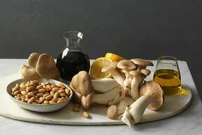 Still life of ingredients for Lord�Stanley's grilled king trumpet mushrooms with almond dip.