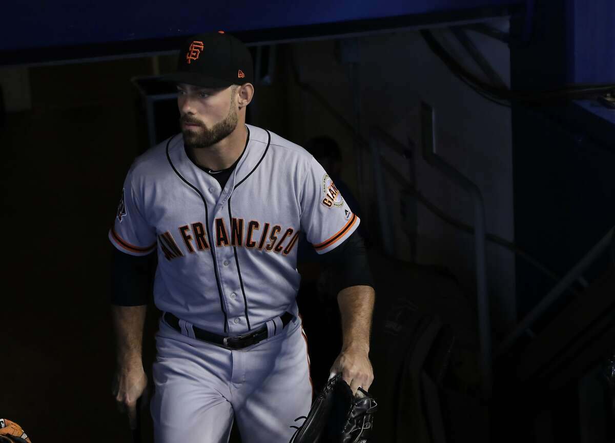 San Francisco Giants' Mac Williamson walks to the dugout before a baseball game against the Miami Marlins, Thursday, June 14, 2018, in Miami. (AP Photo/Lynne Sladky)