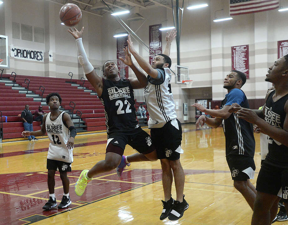 "Aaron Sells puts up a shot against Javawn Wilson as Silsbee gets in practice after school Wednesday as they prepare for upcoming playoffs Friday. The Tigers are setting their eyes on the state championhip again this year, hoping for a ""three-peat"" of their title winning streak. Photo taken Wednesday, February 20, 2019 Kim Brent/The Enterprise Photo: Kim Brent/The Enterprise"