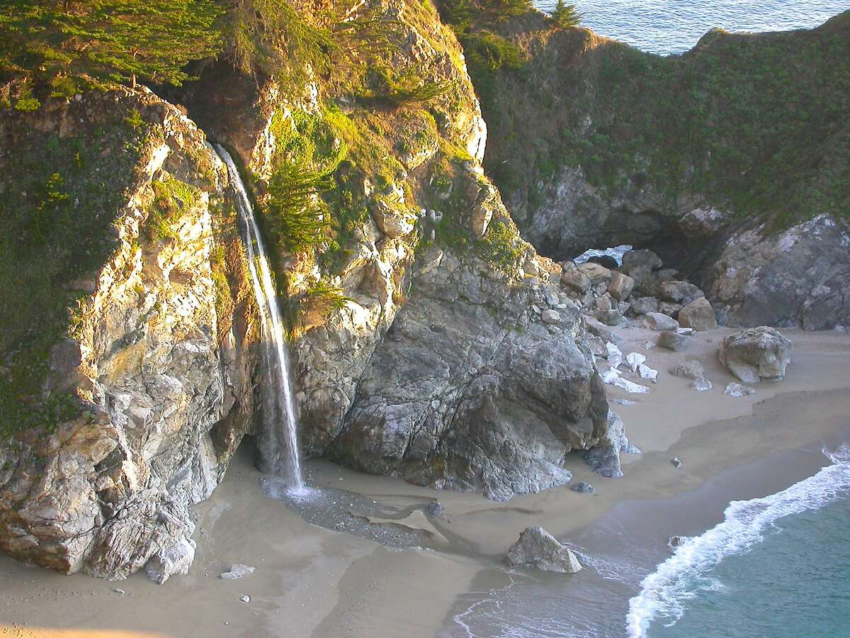 McWay FallsBig Sur This waterfall, which drops 80 feet onto the beach below, is worth pulling over for on your Highway 1 road trip. Located in Julia Pfeiffer Burns State Park, the waterfall is only visible from a trail, but you'll only have to walk about a quarter-mile. More info.