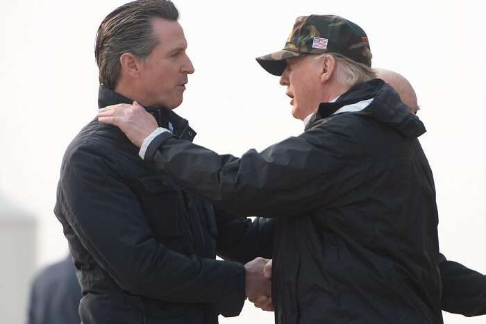 "(FILES) In this file photo taken on November 17, 2018 US President Donald Trump greets California Governor-elect Gavin Newsom (L) as he disembarks from Air Force One upon arrival at Beale Air Force Base in California, as he travels to view wildfire damage. - In a rebuke to President Donald Trump, the governor of California on February 11, 2019 was set to sign an order to pull most of the National Guard troops deployed on the Mexico border. Governor Gavin Newsom's office said he was signing the order ahead of his State of the State speech on Tuesday.""The border 'emergency' is a manufactured crisis,"" according to excerpts of the speech sent to AFP by his office. ""And California will not be part of this political theater."" (Photo by SAUL LOEB / AFP)SAUL LOEB/AFP/Getty Images"