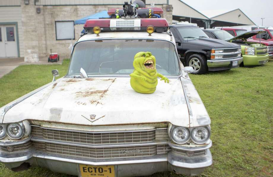 "A replica of Ecto-1 the car used in the ""Ghostbusters"" movie franchise is arked next to a variety of trucks and cars Friday, Feb. 22, 2019 during the Lone Star Throwdown at the Lone Star Convention and Expo Center in Conroe. Photo: Cody Bahn, Houston Chronicle / Staff Photographer / © 2018 Houston Chronicle"