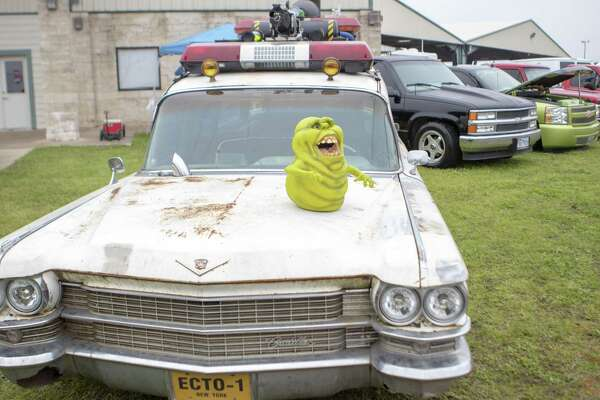"""A replica of Ecto-1 the car used in the """"Ghostbusters"""" movie franchise is arked next to a variety of trucks and cars Friday, Feb. 22, 2019 during the Lone Star Throwdown at the Lone Star Convention and Expo Center in Conroe."""