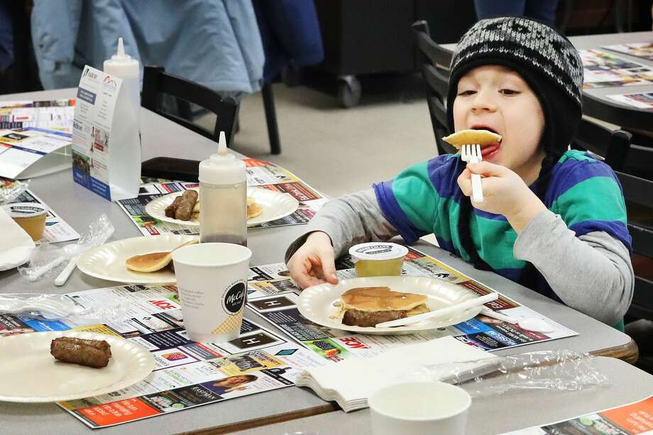 Hundreds of people enjoy pancakes and sausage during the 46th Annual Rotary Pancake Supper & Fundraiser on Thursday, Feb. 21, 2019 at H. H. Dow High School. (Katy Kildee/kkildee@mdn.net) Photo: (Katy Kildee/kkildee@mdn.net)