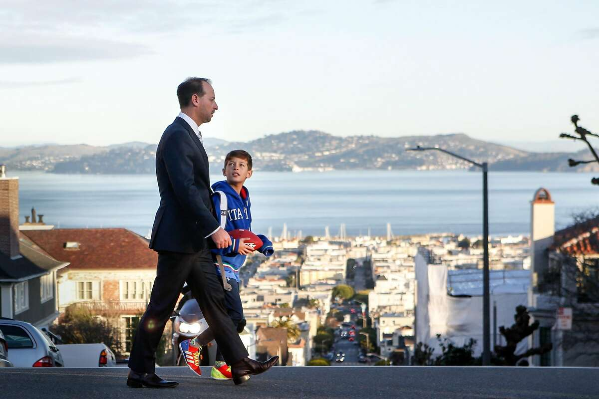 San Francisco District Attorney candidate Joe Alioto Veronese walks son, Augustus Alioto Veronese,10, to school on Wednesday, February 6, 2019 in San Francisco, Calif.