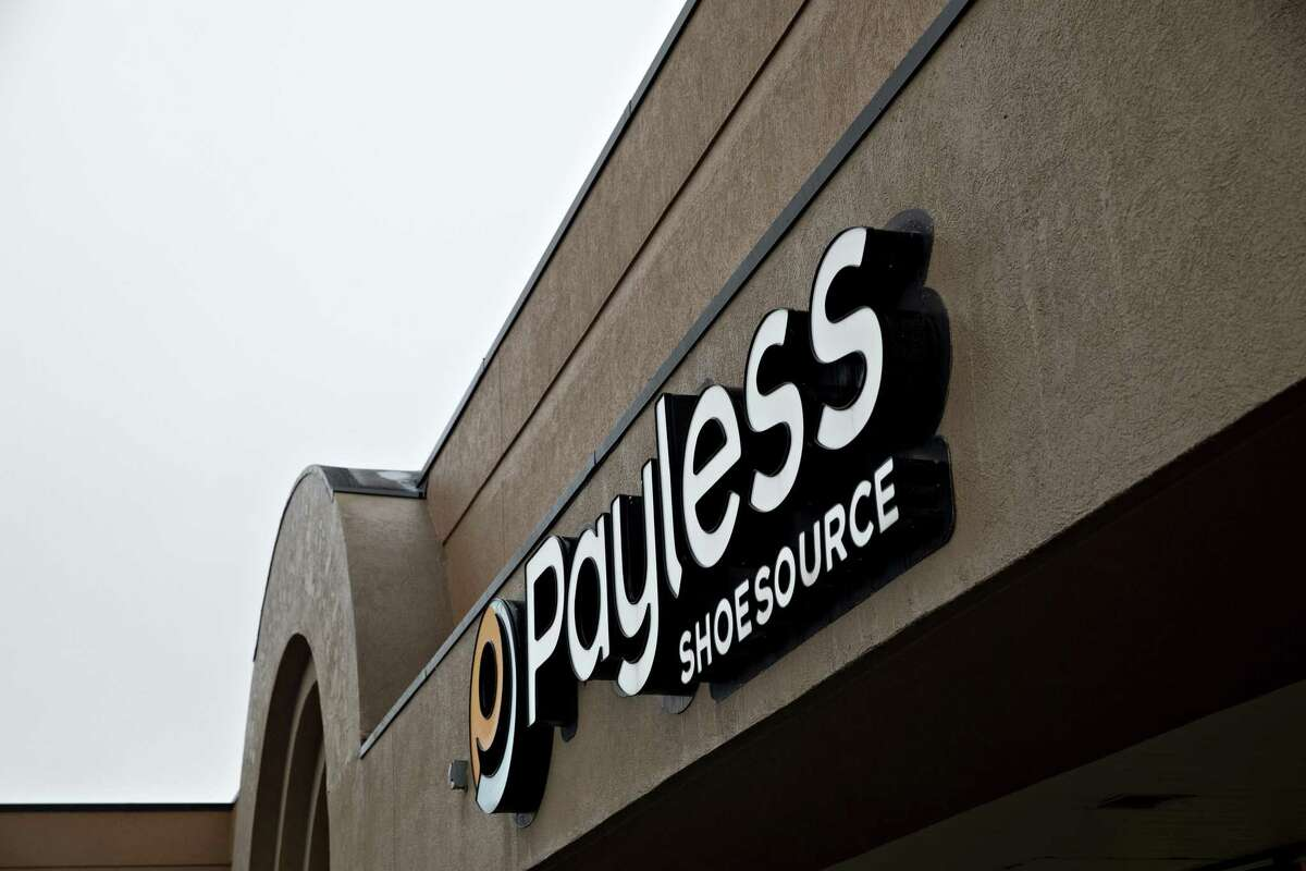 Signage is displayed outside a Payless ShoeSource store in Lansing, Illinois, U.S., on Wednesday, Feb. 20, 2019.