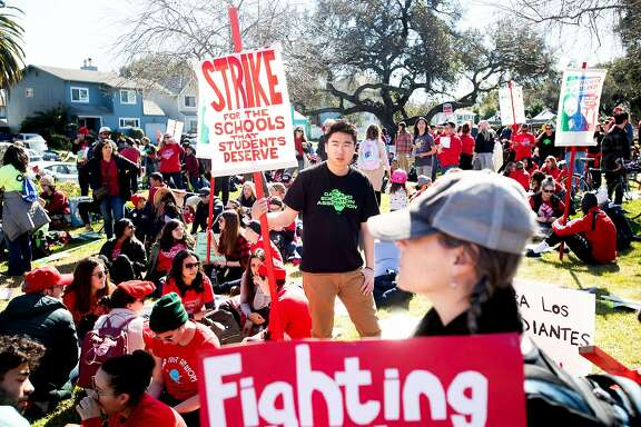 During day two of a teacher strike, Ryan Nam rallies with teachers and their supporters in DeFremery Park on Friday, Feb. 22, 2019, in Oakland, Calif. Nam teaches special education at Oakland's Madison Park Academy.