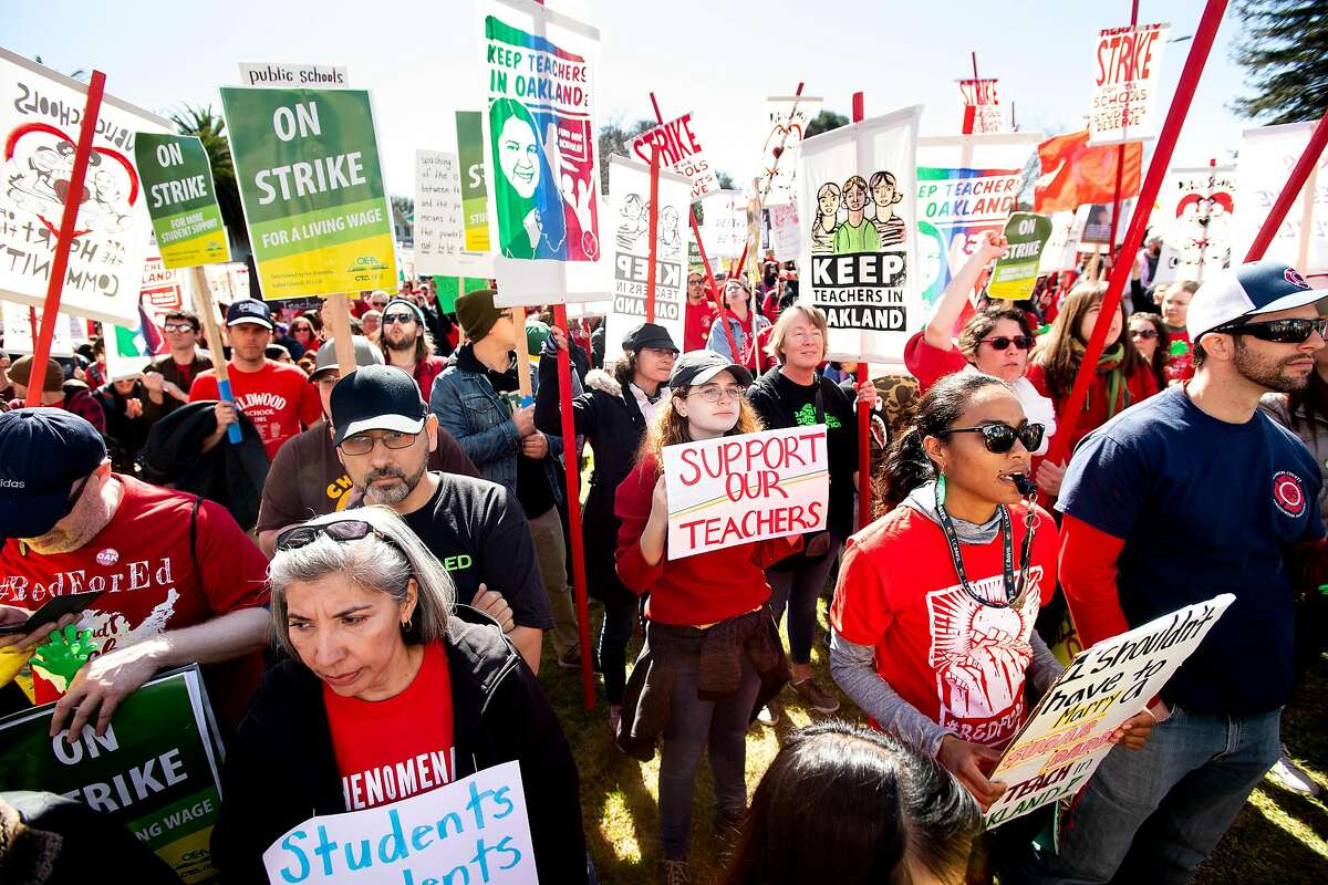 As the Oakland teacher strike enters its second day, Simone Matecna, center, joins teachers and their supporters rallying in DeFremery Park on Friday, Feb. 22, 2019, in Oakland, Calif.