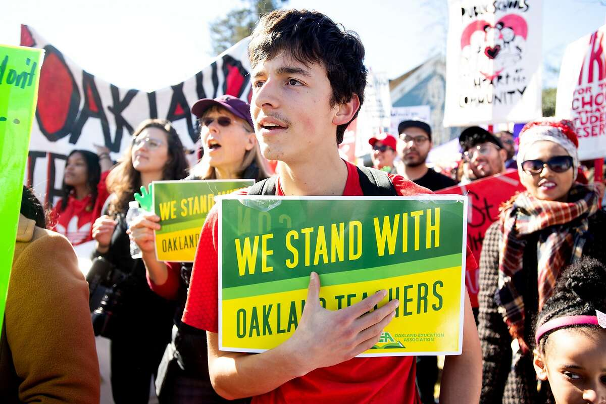 As an Oakland teacher strike enters its second day, Jonathan Conover, 17, rallies with teachers and their supporters in DeFremery Park on Friday, Feb. 22, 2019, in Oakland, Calif.