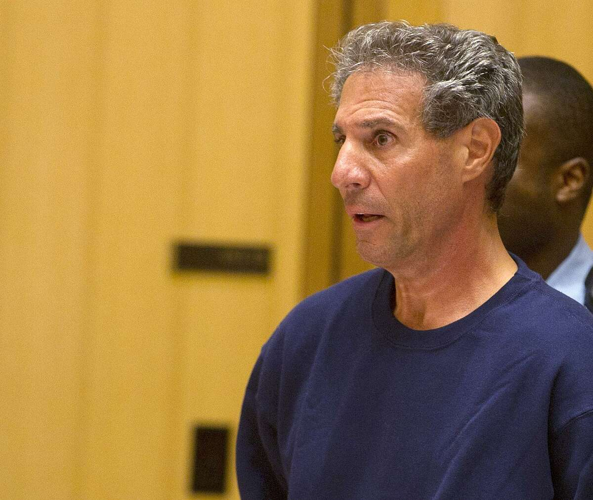 Michael DeMaio, 55, is arraigned on Wednesday, Sept. 11, 2013, on charges of criminal attempt at murder and first degree assault after his wife, Diane, was beaten with a baseball bat in their Greenwich, Conn., home Tuesday evening.