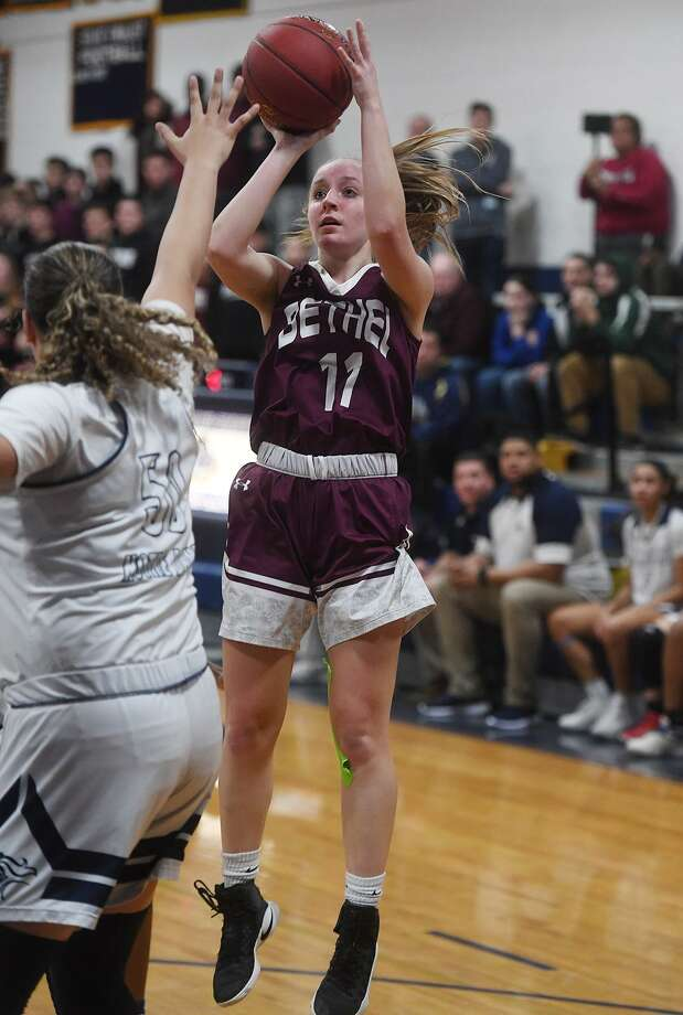 Bethel's Vicky Gracy pulls up for a jump shot over Notre Dame-Fairfield defender Laryssa Guimaraes in the first half on Monday. Photo: Brian A. Pounds / Hearst Connecticut Media / Connecticut Post