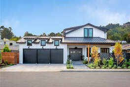 149 Jamaica St. in Tiburon is a five-bedroom contemporary smart home with retractable glass walls, three garages and more than 4,800 square feet of living space.